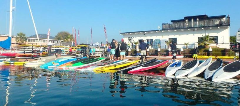 Stand up paddleboards lined up and ready to race on San Francisco Bay