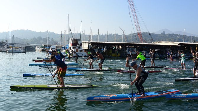 The long course SUP Racers race off the line