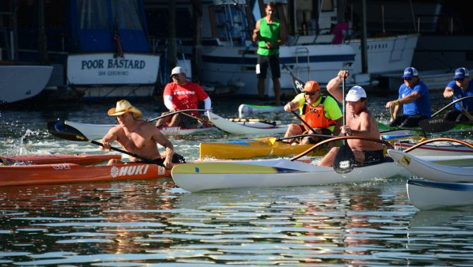 Surfski's, Outrigger Canoes, and kayaks head off the line to race on San Francisco Bay