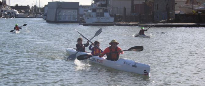 Mike Staninec and family on the triple surfski